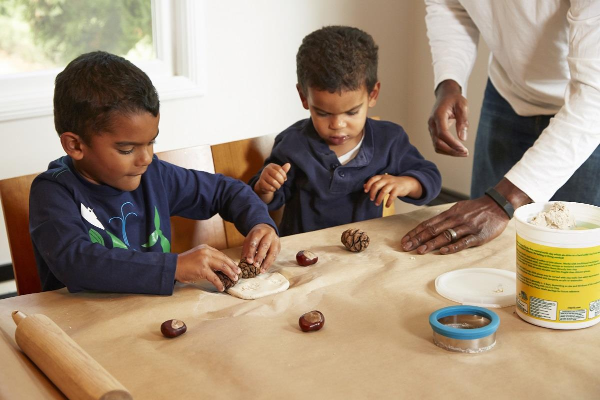 boys clay pinecones