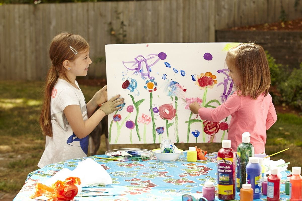 two girls painting roses
