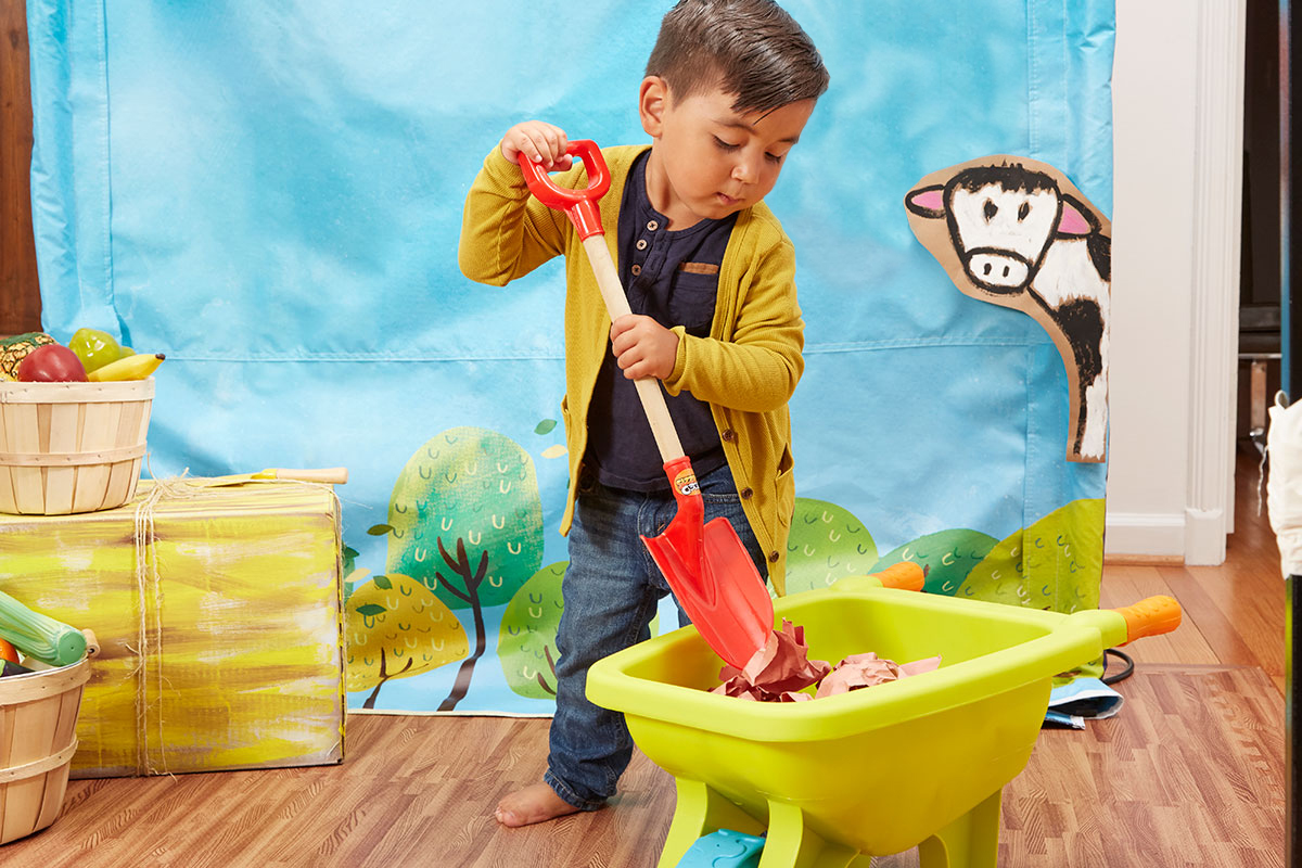 little boy using toy shovel