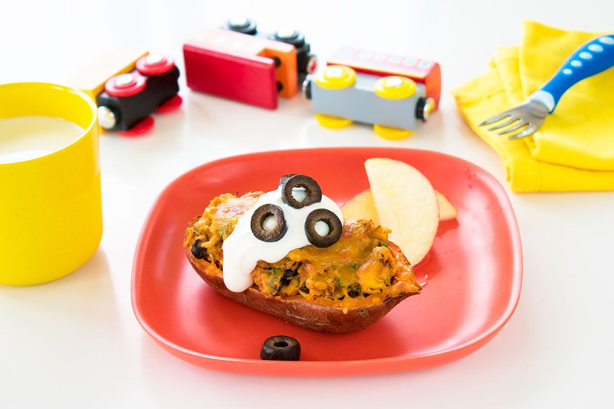 stuffed potato on plate with cream and black olives hero toy trucks