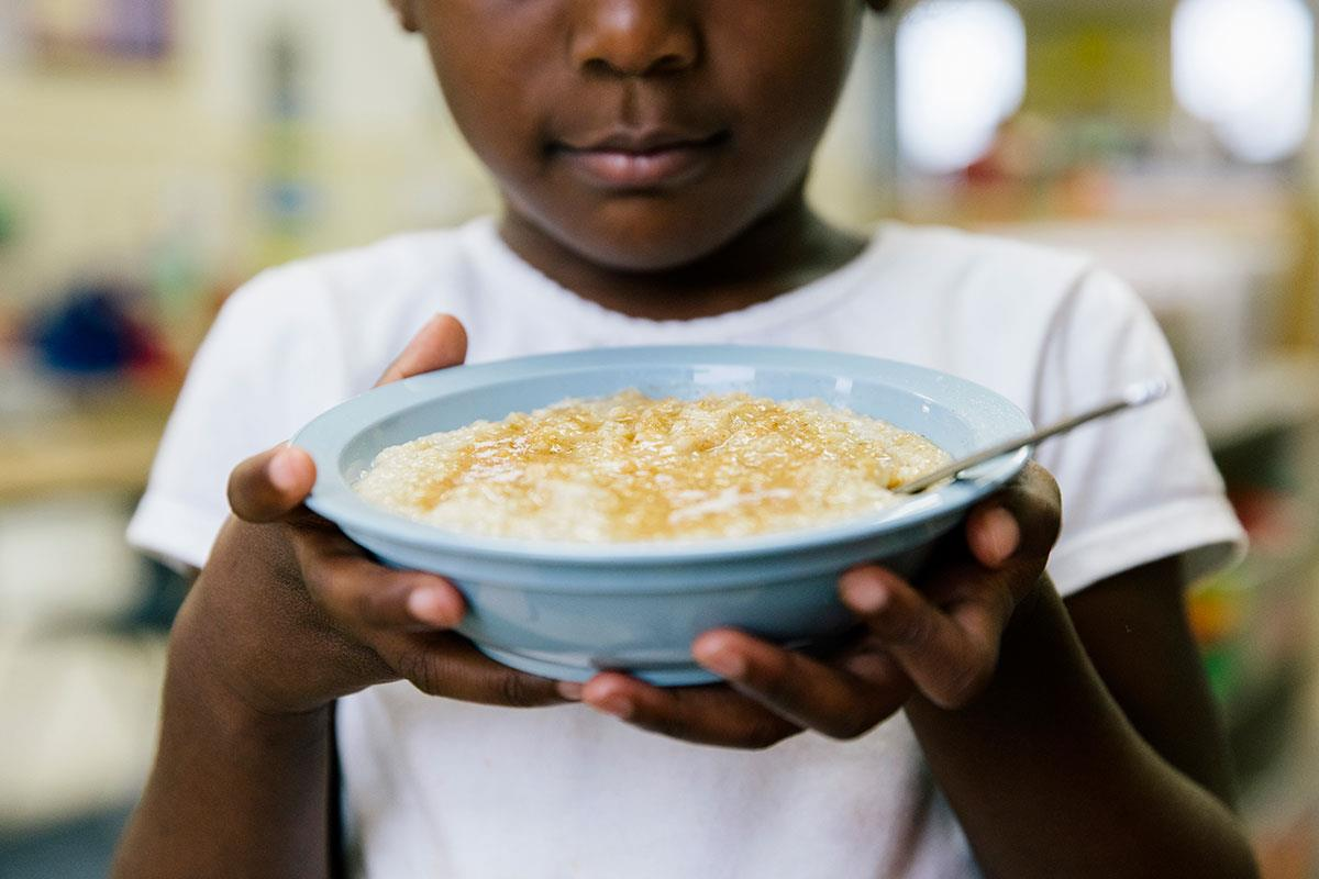 girl holding bowl of oatmeal