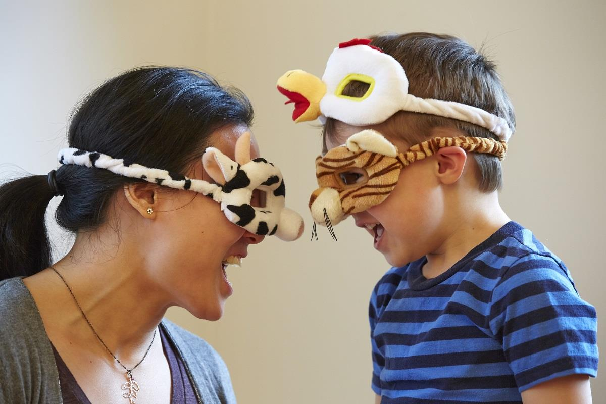 mom and child being silly with animal masks