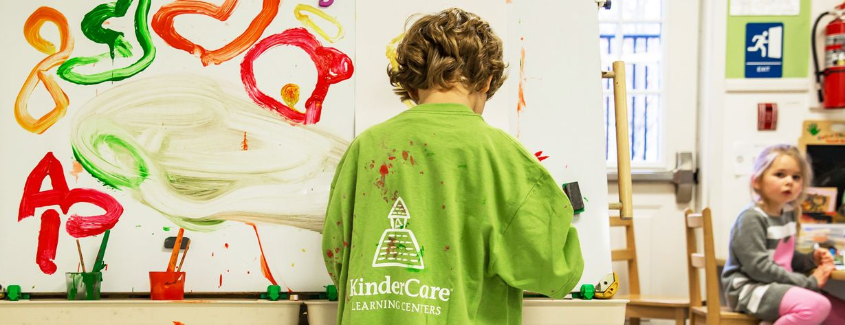 Prekindergartener painting at KinderCare