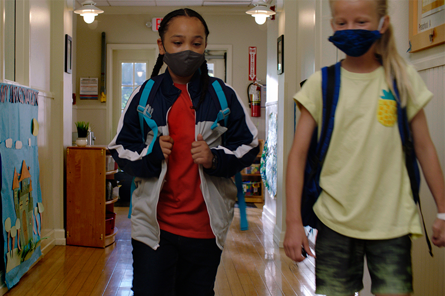 Two kids in school with masks