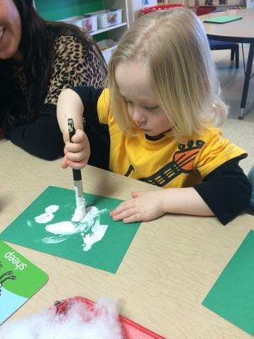 Painting a sheep for the farm unit