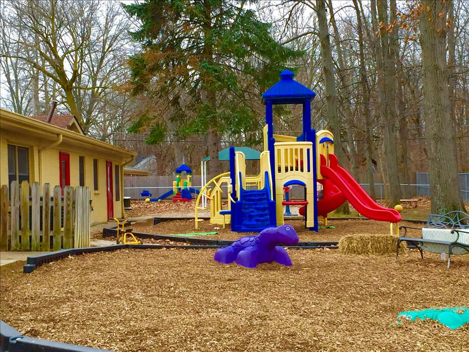 Our children enjoy working on their large motor skills through fun play on our developmentally appropriate playgrounds!