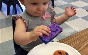 Toddlers love to paint with sponges!