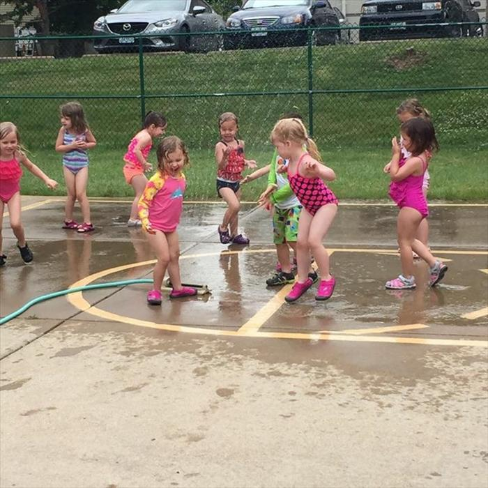 The children love water-play days during the summer!