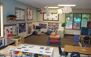 Our toddler classroom is a fantastic area for the children to learn and explore their environment.  In the mornings, the class meets in the library area where they start their morning group time.  The teachers sing, read stories and work with the toddlers on learning the basics such as colors, shapes and numbers.  The carpet area is also where the toddlers get to play and use their imagination in our blocks and music area.
