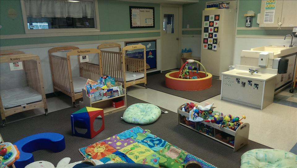"Infants need a safe, secure, ""home away from home"" where they can learn, play, and grow.  Our younger infant room is designed as a smaller space to allow our younger and non-mobile infants to have that close and nurturing environment.  Our teachers talk, sing, and read to our youngest infants to ensure the best start in educational life."