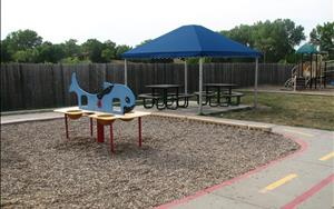 A sensory station and a picnic area is a great place to cool off in the summer heat.