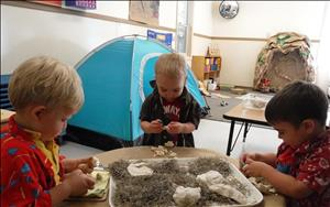 Here, the toddler classroom is discovering dinosaur bones as they pretend to be archeologists.