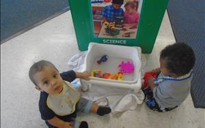 Our infants love exploring and playing in the sensory table.
