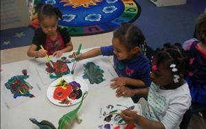 Prekindergarteners learning how to do still-life paintings in art today. Roarrrrrrrrrr!
