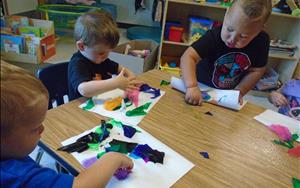Toddlers doing a torn paper collage