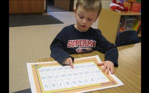 One of our Learning adventure math students practices his counting.