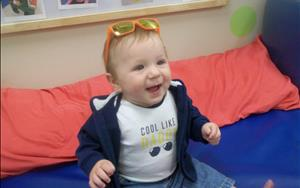 Even our littles ones particiapte in the fun! This little guy is rocking his sunglasses on Beach Party Day!