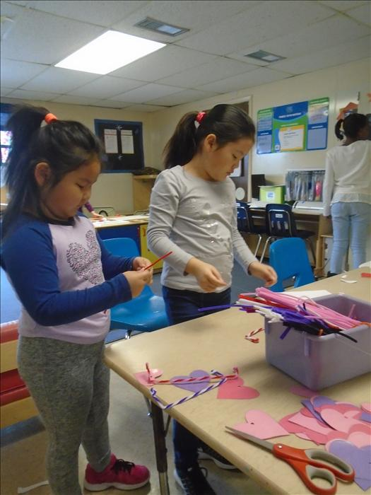 School Age students making Valentines