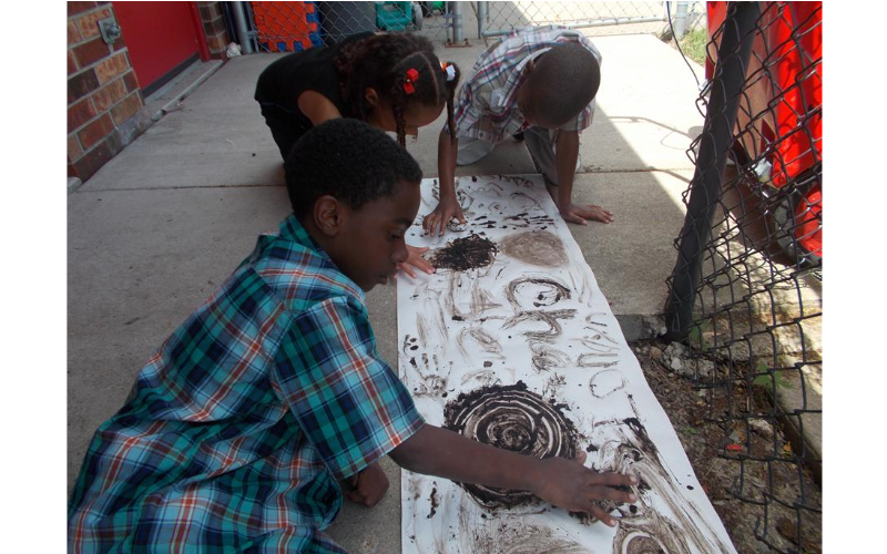 Using different materials for art, like mud, makes creative expression fun and interesting.