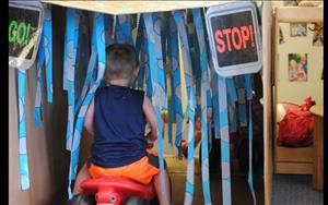 During the water theme one of the Discovery Preschool children washer their car in the KInderwash.