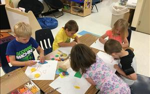 Our Pre-K class had fun creating a masterpiece using the 2-D and 3-D geometric shapes during their math activity.