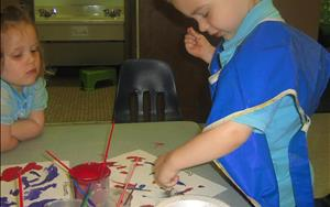 Creative arts are a great way for children to express themselves and explore different feelings and ideas.  We take time every day to paint, move, and sing.