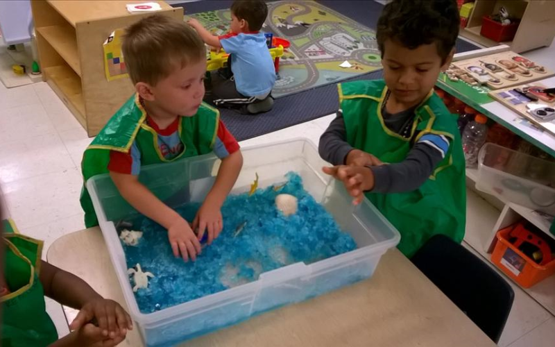 Exploring different textures and feelings in the sensory table is one of the Preschool children's favorite things to do.
