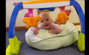One of the infants shows her award winning smile during tummy time.
