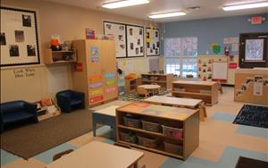 This is our Toddler A classroom. At this age, the room has been arranged in different discovery play areas or centers. Some of these centers include Dramatic Play, Blocks and Building, Creative Arts, and Math and Manipulatives.