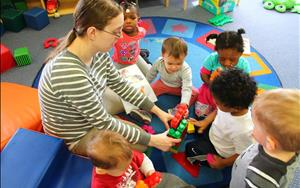 Our toddlers increase their fine motor skills with Ms.Theresa!