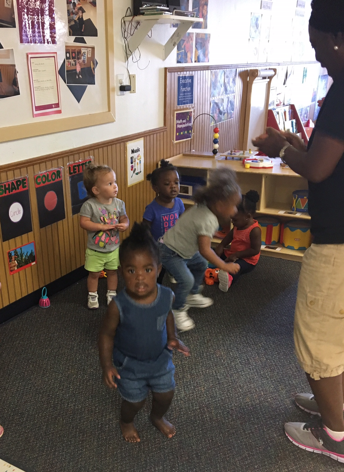Ms. Susannah is helping this classroom use creative expression by letting them sing and dance to different songs. They sure know how to be silly!