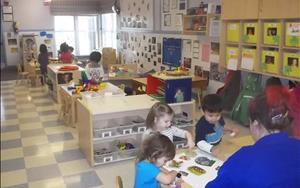 Our Discovery Preschool B children are exploring the classroom during small group learning time