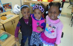 Having a blast in our preschool homeliving area.  Best friends are made here at KinderCare.