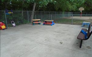 We have a large and spacious playground for the toddlers that provides them plenty of opportunity to be active but to also rest when needed.  There are picnic tables set up outside that allow the children to sit down and rest and enjoy something to drink while they are outside.  The teachers also enjoy having small group activities outside at the picnic tables.