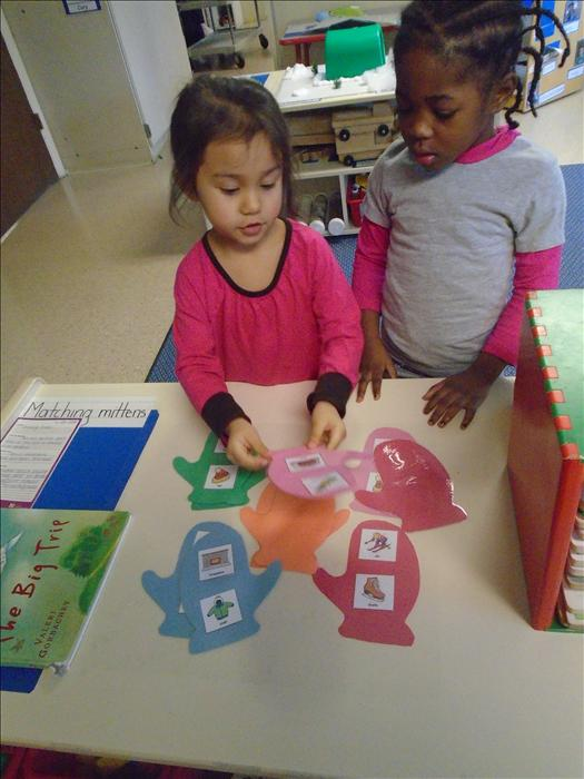 "Preschool students playing ""Match the Mitten"""