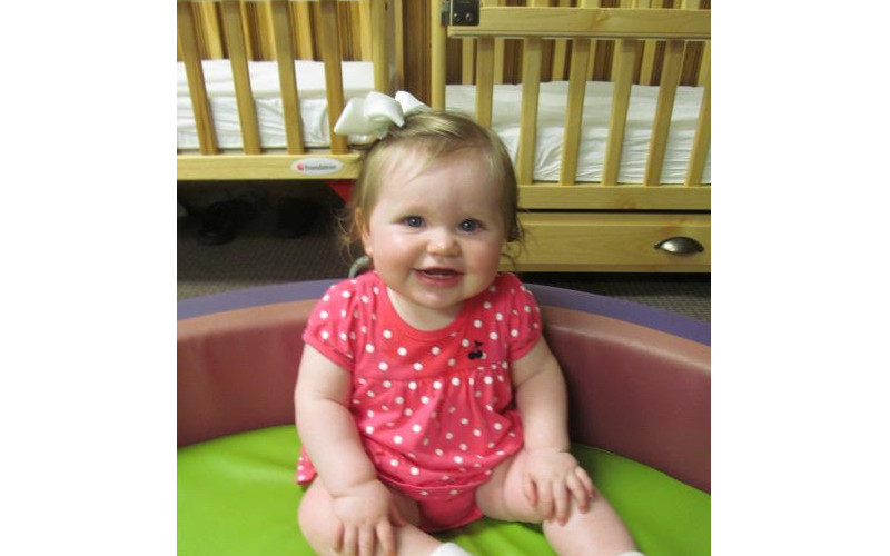 All smiles while playing and learning in our Infant Classroom.