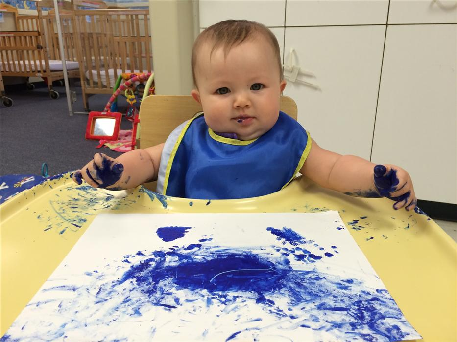 Painting a blue sky in the Infant room!