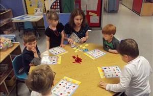 Playing phonics bingo in our Older Preschool classroom