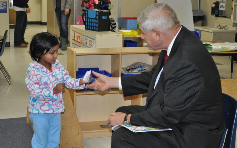 "Preschool friend giving her ""map"" to State Representative Bill Aman on his visit during ""Our Country"" theme."
