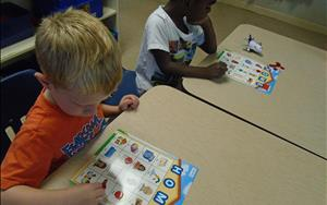 PreK students playing 'home' BINGO during their 'My home and family' theme