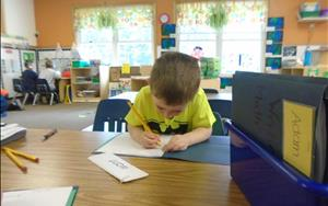 A PreK Student working on sight words