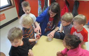 These children are very curious of the activity Ms. Harley has planned. Can we make this potato grow? Let's experiment.