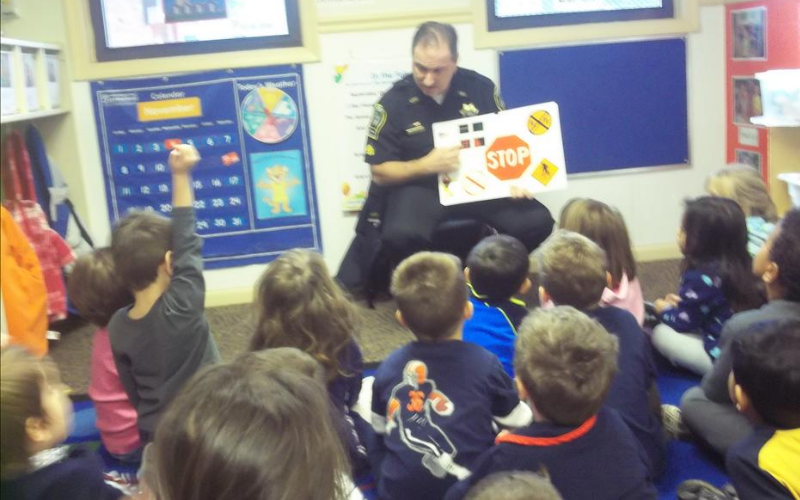 A local police officer visits or KinderCare students.