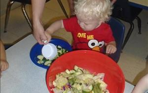 During our Dinosaur theme our Discovery Preschoolers had a chance to make an herbivore salad!