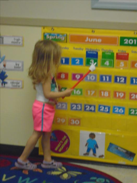 Learning to count by going over the calendar during large group.