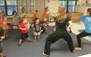 Our children love being involved in our in center field trips! Here they are taking a karate class!