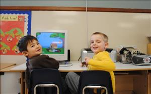 Two Prekindergarten boys enjoy a little educational computer time.