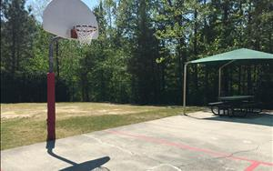 We have a basketball court  and soccer field for older children to enjoy some fun games!