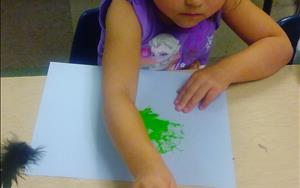 Our Prekindergarten class gets to express themselves using different equipment to paint with, today it was feathers!
