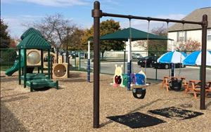 Infant and Toddler Playground: We have swings, climber, sandtables, picnic tables and lots of space for riding trikes and climbing. Your child will have the opportunity to play outside every morning and afternoon.